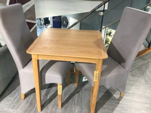 ex display chive dining table and grey chairs